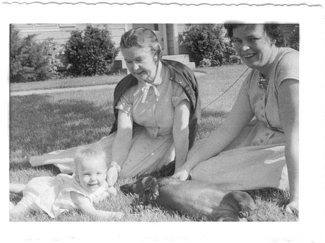 [Ruby, my Grandmother, her daughter Barbara, and me,on the blanket, in front of the house I grew up in]