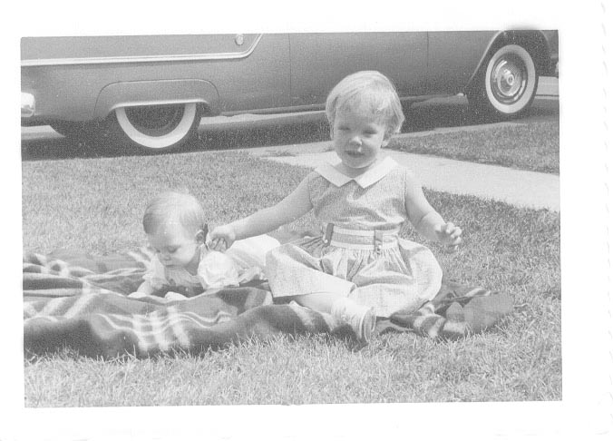 [ my sister, lisa and me. I am seated she is lying down (1959?)]