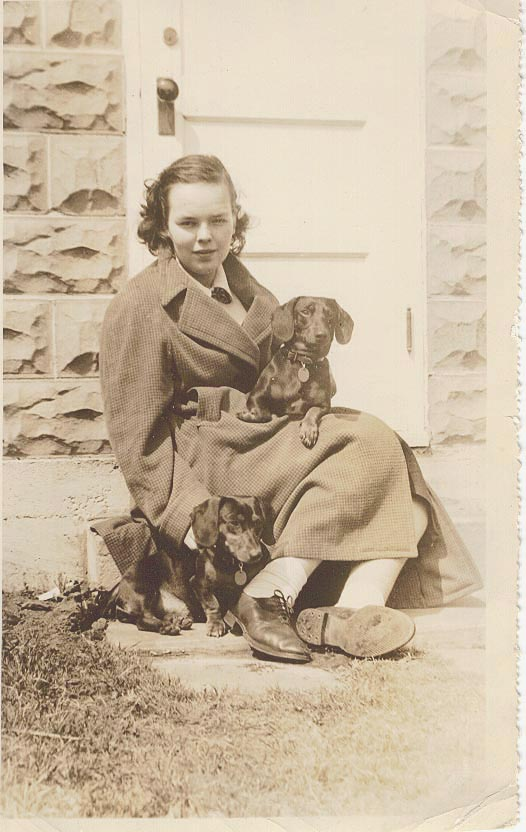 [ my mother at 17 (1937) with her 2 dogs]