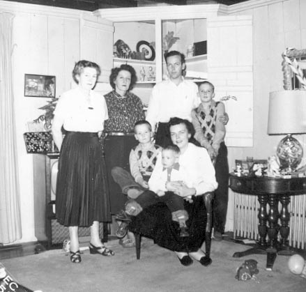[My Mother, her brother Max, his wife, their three sons,my grandmother. Taken at grandmother's house in Attleboro MA, Christmas 1955]