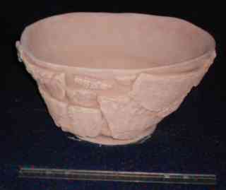Unfired bowl with basket decorations