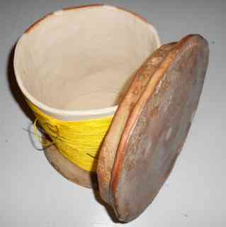 Sewing box in the form of a spool with lid off