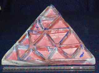 Triangular serving plate with triangular sections