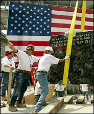 [the cornerstone of the new Freedom Tower set to rise above the NY Skyline at 1776 feet, laid at Ground Zero on 4 July 2004]